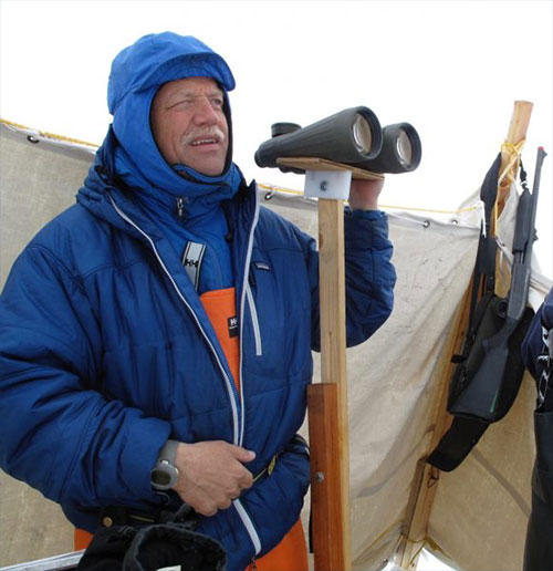 jpg Craig George, a North Slope Borough biologist, looks for migrating bowhead whales north of Utqiagvik in May 2010.