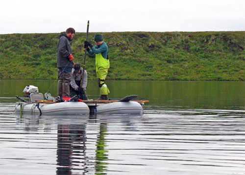 jpg Researchers working with ecologist Nancy Bigelow pull a sediment core from a deep lake in western Alaska near Shishmaref, looking for pollen preserved from the days of the Bering land bridge.