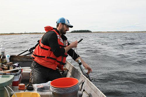 jpg Study lead Matthew Bogard, a University of Washington postdoctoral researcher, samples water from Canvasback Lake in Yukon Flats National Wildlife Refuge