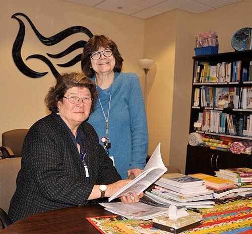 Volunteers multi-task at Cancer Resource Center