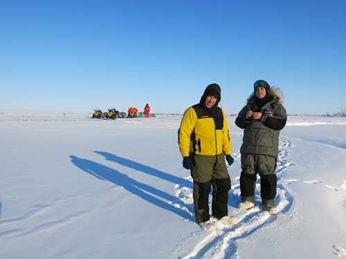 jpg Chris Arp, left, and Ben Jones on the North Slope during a snowmachine journey to study lakes in spring 2014. Guido Grosse of Potsdam, Germany, is in the background. 