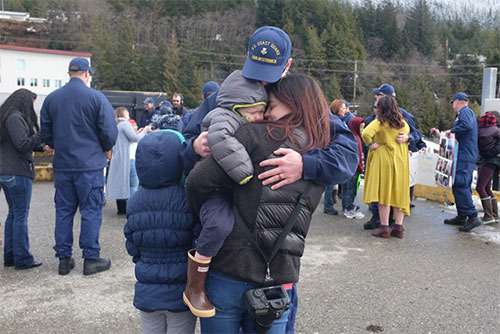 jpg Petty Officer 1st Class Andrew McCormick, a crew member aboard the Coast Guard Cutter John McCormick, greets his family after the Fast Response Cutter and crew arrived at its new homeport in Ketchikan