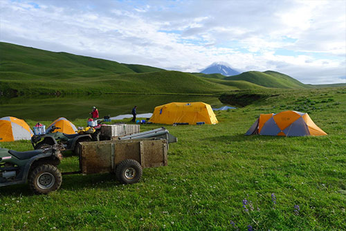 jpg Geologists camped near an upland lake about 0.5 km from the shore of Driftwood Bay, Umnak Island, Alaska. Vsevidof Volcano in the background.