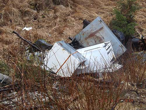 jpg A fuel tank and appliances dumped by the dog park in 2014 a month after the area had been cleaned by the Coast Guard