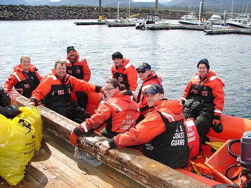 jpg The crew from the Naushon picking trash from Ketchikan breakwaters