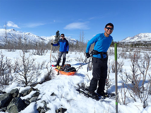 jpg From left, graduate students Yadong Wang (University of Utah) and Kyle Smith (UAF), haul gear for installing temporary seismometers on the Denali Fault south of Delta Junction.