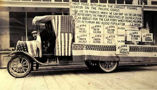 jpg Carl Cordell with a decorated truck in the Fourth of July Parade, 1917, shows the more serious side of the community's wish for a ferry system.