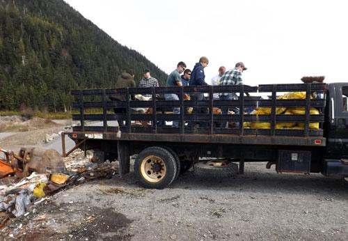 jpg Coast Guard members unloading the 7 ton truck at the landfill