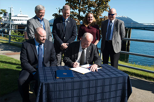 jpg Governor Walker Signs Memorandum of Understanding with Southeast Conference to Improve Ferry System as other officials look on...