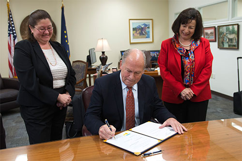 jpg HB 234 signing: Gov. Walker with Rep. Vazquez and staffer