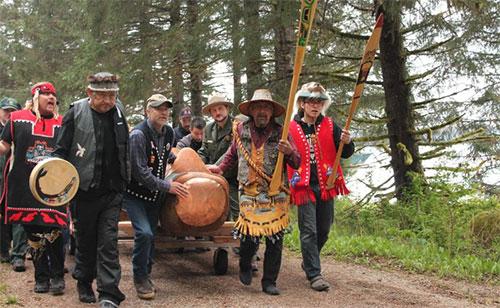jpg Eagle Pole is carried to the Tribal House