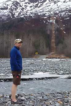 jpg Ned Rozell pauses on the path of the trans-Alaska pipeline near Valdez in 2017.