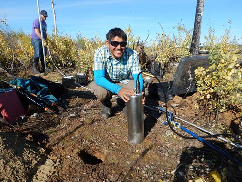 jpg University of Alaska Fairbanks doctoral student Kyle Smith installs a T120 posthole seismometer at a site in the Minto Flats of central Alaska in September, 2015.