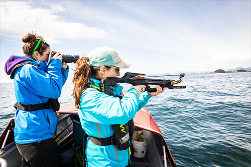 jpg Lauren Wild and Madison Kosma prepare to tag a whale. NOAA permit #18529.