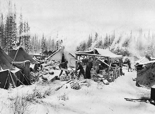jpg One of the first camps along the Alcan Highway route to be set up in the northern regions of Alaska. A sawmill supplied building materials and wood for fires
