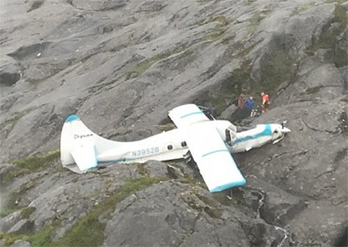 jpg 11 rescued from plane crash on POW