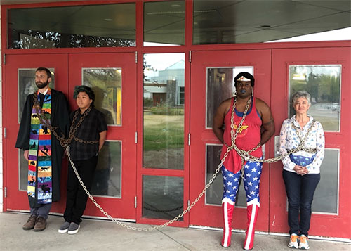 jpg Wasilla protesters chained in front of door to Wasilla Middle School