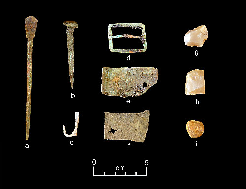 jpg A representative collection of artifacts discovered in July 2015 includes (from left) part of a set of dividers, a nail, a fishhook, a buckle, sheet copper, gun flints and a musket ball.
