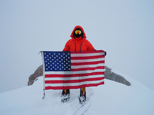 jpg apt. Stephen Austria, project engineer in the USACE-Alaska District's Foreign Military Sales Program, carried this American flag on his expedition climbing Denali this past summer.