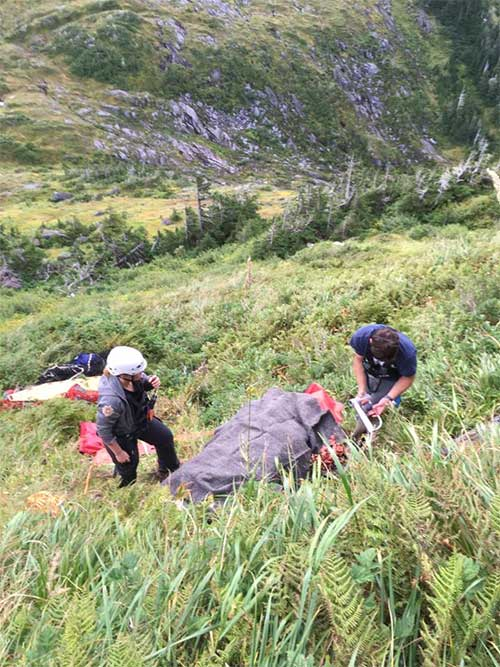 "jgp The team ""packaged"" Green and set up a rope system preparing to lower him to a medevac helicopter."