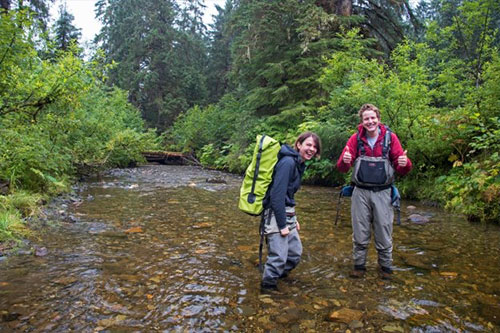 jpg UAS Environmental Science Students Mollie Dwyer (left) and Connor Johnson trek through Montana Creek to obtain water samples Thursday, Aug. 23, 2018 in Juneau, Alaska.