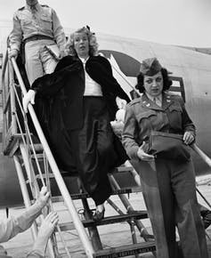 jpg Mildred Gillars, center, known to American GIs in WWII as 'Axis Sally,' arrives in the U.S. to face a treason charge.