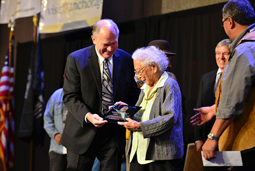 jpg The 2015 Shirley Demientieff Award is presented to Poldine Carlo of Fairbanks by Governor Bill Walker...