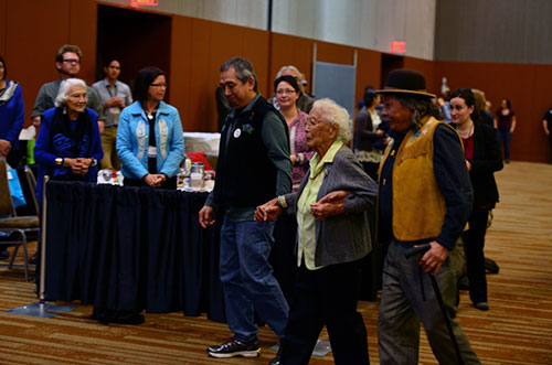jpg This year's Shirley Demientieff Award recipient Poldine Carlo is escorted to the stage at the annual Alaska Federation of Natives Convention in Anchorage.