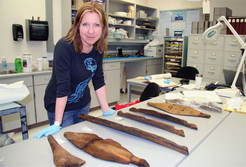 jpg Researcher Jenya Anichenko poses with the umiak pieces discovered in the Birnirk collection at the University of Alaska Museum of the North and dated at 1,000 years old