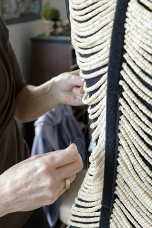 jpg Sitka artist Cynthia Gibson works on her salmon bone dress, which contains approximately 20,000 vertebrae.
