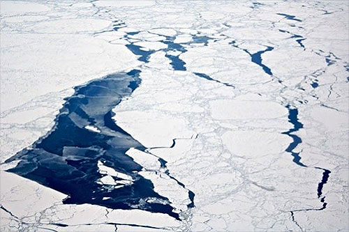 jpg Sea ice floats near Little Diomede Island in the Bering Strait.