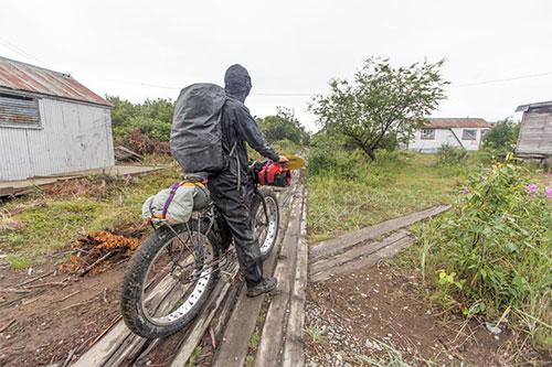 jpg Riding through a village duringBjørn Olson's trip from Cook Inlet to Bristol Bay