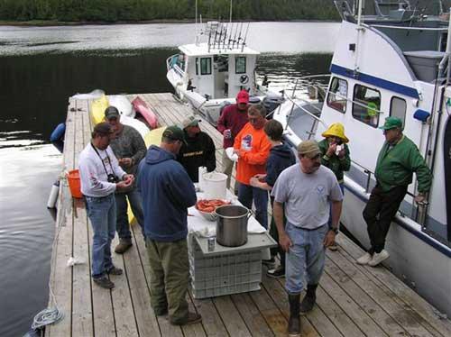 jpg 12'x70' Float with Sportfisherman tied up