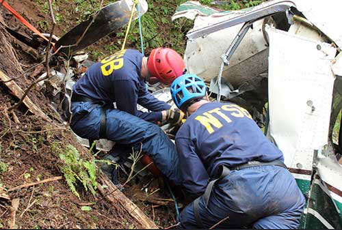 jpg NTSB investigators Brice Banning and Clint Crookshanks on scene examining the wreckage of a sightseeing plane that crashed in Alaska on June 25, 2015.