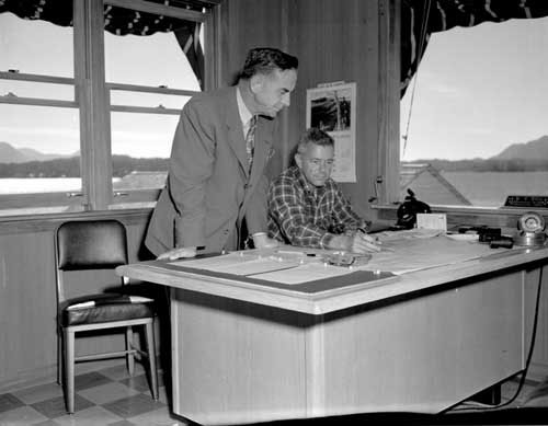 jpg Bob Ellis at his desk during the search for the Hall plane, August 1953