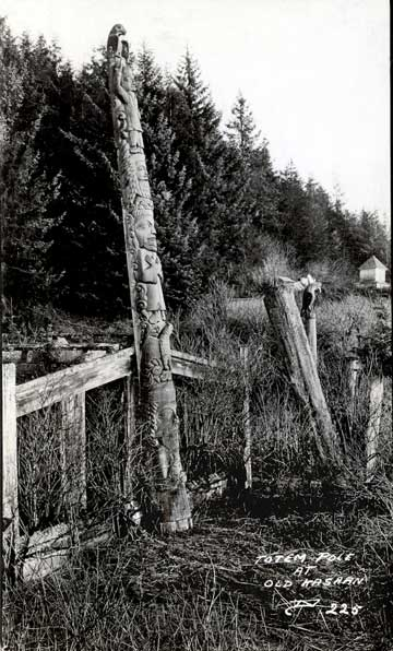 jpg Totem pole and house remains at Old Kasaan