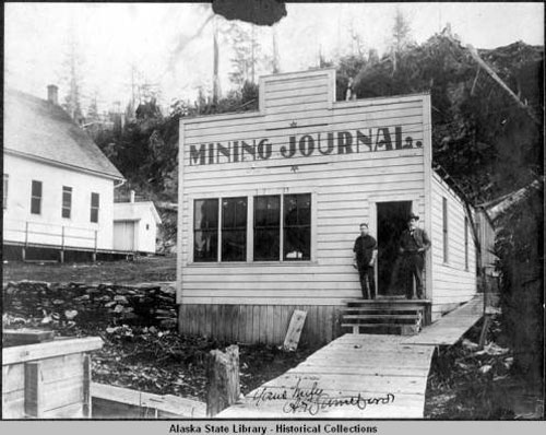 """jpg Front of small wooden building that housed Ketchikan's newspaper """"Mining Journal"""""""