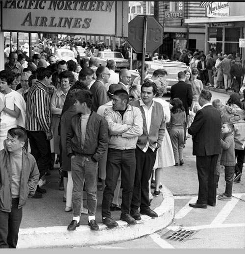 jpg People on the street in Ketchikan in front of Pacific Northern Airlines building, July 5, 1967