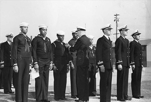 jpg Rear Admiral Carlton H. Wright pinning the Navy and Marine Corps Medal on Seaman 1st-class James A. Camper, Jr. for heroism displayed following the Port Chicago munitions explosion 17 Jul 1944.