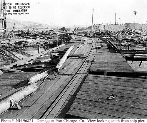 jpg View from the demolished pier looking toward shore and more flattened buildings following a munitions explosion at Port Chicago, California, United States, 17 Jul 1944. 18 Jul 1944 photo.
