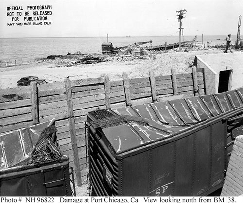 jpg Railroad cars full of munitions in a revetment at Port Chicago, California, United States damaged by a massive explosion the night before.