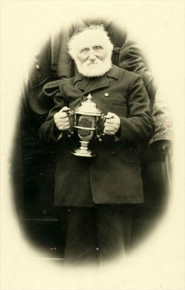 jpg Father William Duncan of the Church of England in Alaska holding a silver cup. n.d. Photographer: Alice O. Swanson. William Duncan, 1832-1918