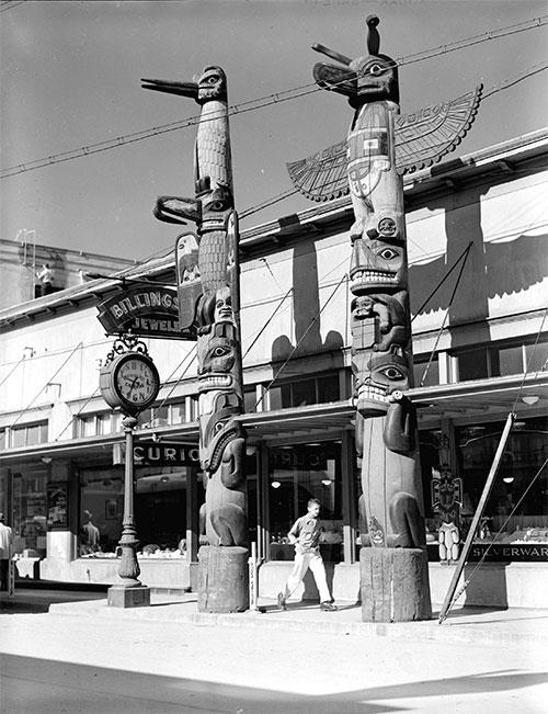 jpg View of totem poles in front of Billingsley Jeweler, Ketchikan - Sept 1949