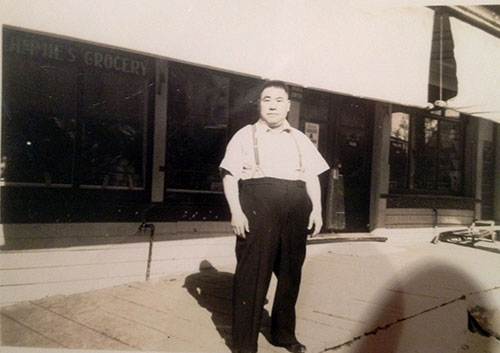 jpg Jimmie Tatsuda standing in front of his first store Jimmie's Grocery at 415 Stedman Street in Ketchikan.