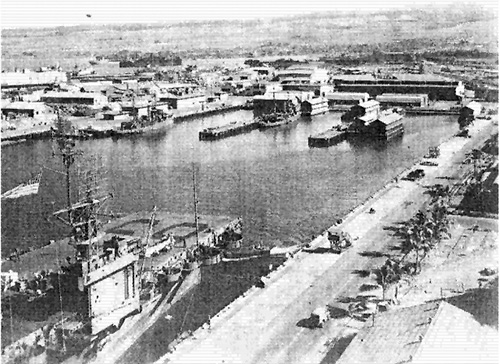jpg Pearl Harbor: USS Kasaan Bay (CVE-69) in the foreground.