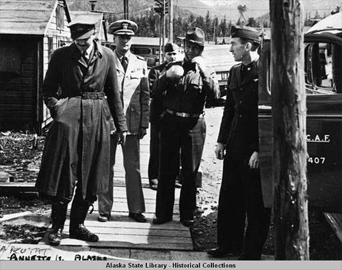 jpg Five men, all in uniforms, on wooden sidewalk at Annette Island, Alaska, April 1942